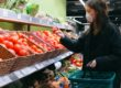 woman wearing mask and buying food in supermarket during coronavirus pandemic