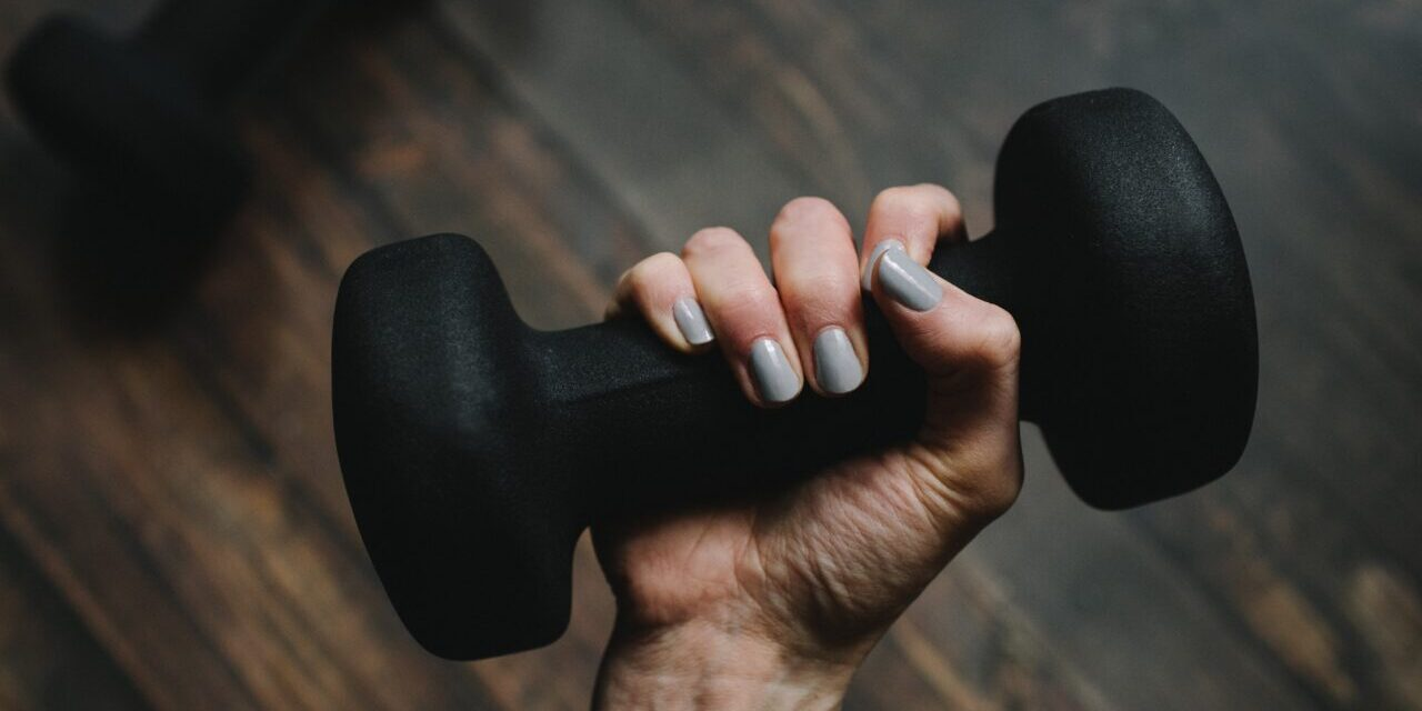 person holding dumbbell