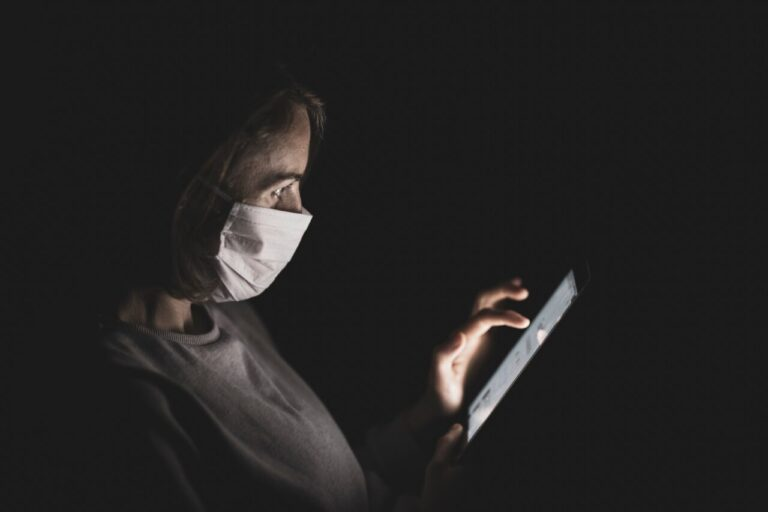 woman wearing mask on phone