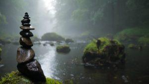 balanced rocks in mist