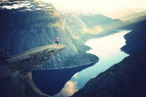 balancing on cliff